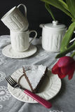 Swedish chocolate cake. A piece of chocolate cake on a white knitted ware Royalty Free Stock Photography