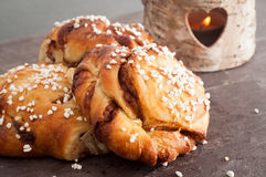 Swedish cinnamon buns. Traditional Swedish cinnamon buns served on a rustic plate. A very popular snack throughout Scandinavia known as Fika when taken with a Stock Photography