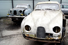 Swedish Classic Cars - In the Junk Yard. Two old swedish classic cars parked in a junk yard Royalty Free Stock Image