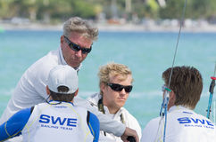 The Swedish coach confers with his 49er sailors at 2013 ISAF Wor. MIAMI, February 2, 2013 - Theater-style racing is designed to attract spectators, sponsors and Royalty Free Stock Images