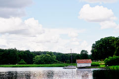 Swedish cottage and boat Stock Photography