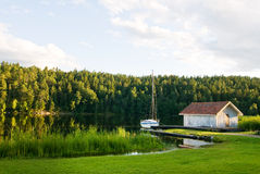 Swedish cottage and yacht Royalty Free Stock Photography