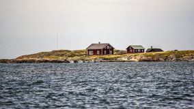 Swedish cottages off the Swedish coast in Varberg stock images
