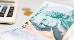 Swedish crown currency  calculator money concept. Swedish crown currency and calculator money concept Stock Photos