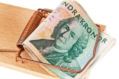 Swedish crowns. Swedish currency. Swedish krona, the currency of Sweden. With mousetrap. Debt and budget Stock Photo