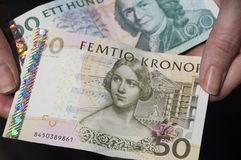 Swedish currency. Hands holding Swedish Krona currency Stock Photos