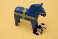 Swedish Dala horse. Dala horse in the same color as Swedish flag popular as souvenir from Sweden Stock Photo