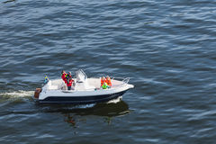 Swedish family does a boat trip. Vaxholm, Sweden - May 6, 2016: Ordinary Swedish family does a boat trip on a small motorboat stock photos
