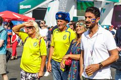 Swedish family watching match of Sweden national football team. stock photo