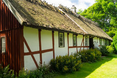 Swedish farm house. Old charming Swedish half timbered farm house with thatched roof of straws Royalty Free Stock Photos