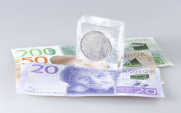 Swedish Five Krona Coin in Ice Stock Image