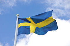 Swedish flag. With a cloudy sky Royalty Free Stock Photography