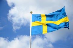 Swedish flag. A swedish flag against blue sky Royalty Free Stock Image