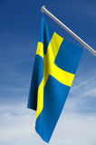 Swedish Flag. With clipping path, hanging on flagpole, blue sky stock illustration