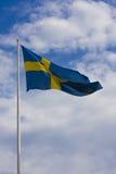 Swedish flag. On sky background Royalty Free Stock Photos