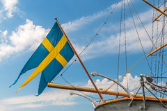 Swedish flag on the back of an old sailing ship Stock Image