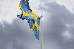 Swedish Flag blowing in the wind. stock photo