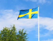 The Swedish flag. With a blue sky Stock Photo