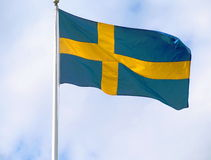 Swedish flag. The swedish flag with blue sky Stock Photos