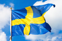 Swedish flag blue with yellow cross waving in the wind Stock Photography