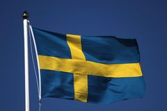 Swedish Flag On Dark Blue Sky Royalty Free Stock Photography