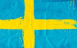 Swedish flag daubed with paint Royalty Free Stock Photos