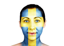 Swedish flag on a face. Swedish flag on a woman face Royalty Free Stock Photos