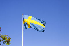 Swedish flag. In front of a blue sky Royalty Free Stock Images