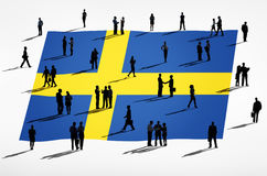 Swedish Flag. And a group of business people Royalty Free Stock Image