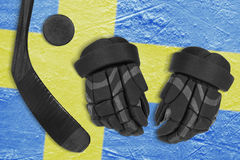 Swedish flag, hockey puck, stick and gloves Royalty Free Stock Photography