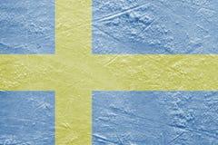 Swedish flag on the ice Stock Photos
