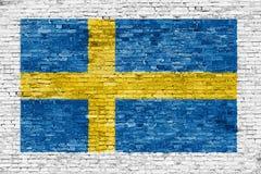 Swedish flag painted over white wall. Swedish flag painted over white brick wall Stock Photography