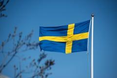 Swedish flag on a flag pole stock photo