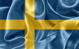 Swedish flag. Swedish satin flag On fabric texture Royalty Free Stock Photos