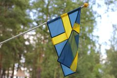 The swedish flag. On a rainy day stock photos