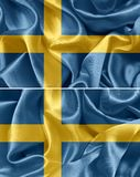 Swedish flag. Swedish satin flag. textile background Royalty Free Stock Images