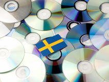 Swedish flag on top of CD and DVD pile isolated on white. Swedish flag on top of CD and DVD pile isolated Stock Image
