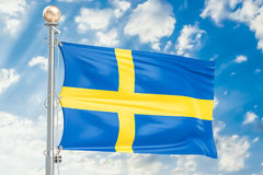 Swedish flag waving in blue cloudy sky, 3D rendering Royalty Free Stock Photos