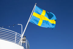 Swedish flag waving over blue sky Stock Image
