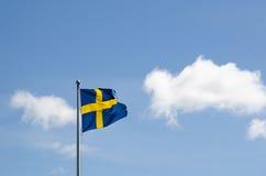 Swedish flag waving at a summer sky Stock Image