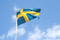 Swedish flag. With wind a lovely summer day in Sweden Royalty Free Stock Photo