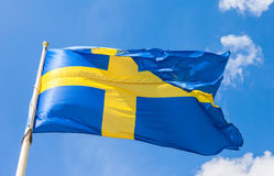 Swedish flag with yellow cross waving in the wind Royalty Free Stock Image