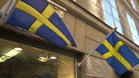 Swedish flags on the facade of the building. In the Old Town in Stockholm stock video footage