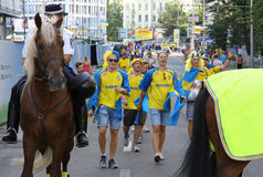 Swedish football fans walk on the streets of Kyiv city Royalty Free Stock Photography