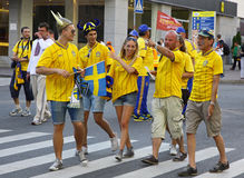 Swedish football fans walk on the streets of Kyiv city Stock Photos