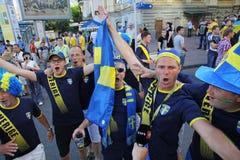 Swedish football fans walks on the streets of Kyiv city Stock Image