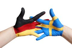 A swedish and a german painted hand Stock Images