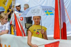 Swedish girl supporter with umbrella at the World Orienteering Championships in Lausanne, Switzerland royalty free stock photos