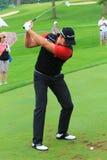 Swedish golfer Henrik Stenson Taking a Shot. Pro golfer Henrik Stenson prepares to hit the ball at the country clubs PGA golf invitational royalty free stock photo