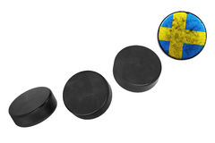 Swedish hockey pucks. Lined up in a row on white background Royalty Free Stock Photos